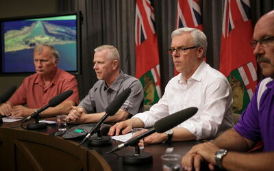 Premier Greg Selinger (second from right) announces a worsening flood forecast, joined by (from left) Steve Topping of the Emergency Measures Organization,  Doug McMahon from Manitoba Infrastructure and Lee Spencer of the EMO.