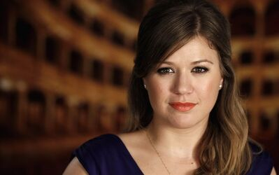 "In this Sept. 22, 2011 photo, singer Kelly Clarkson poses for a portrait in Los Angeles. Clarkson's newest CD, ""Stronger,"" was released on Tuesday, Oct. 25. (AP Photo/Matt Sayles)"