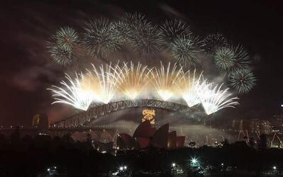 Fireworks explode in the sky above Sydney Harbour during the New Years Eve celebrations in Sydney, Australia, Tuesday.