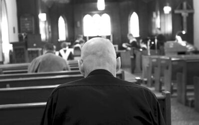 A man prays at Holy Trinity Anglican Church in Killarney, Man., in February. Many churches face closure as people's belief in the importance of religion declines.