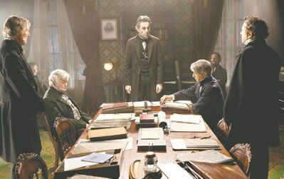 David James  / DreamWorks, Twentieth Century Fox Daniel Day-Lewis (centre rear) as Abraham Lincoln in a scene from the film. Director Steven Spielberg makes no apologies for the movie�s ending, though many feel it should have come sooner.
