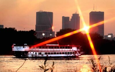 The Paddlewheel Queen drifts along the river.