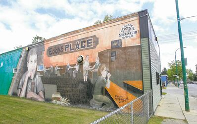 A mural on the side of Eddy�s depicts patrons enjoying great food and good company.