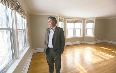 Real estate agent  Chris Pennycook stands inside the former university presidents' home at 49 Oak Street. The home, which was purchased  by the University  of Winnipeg for $26,500 in 1955, is on the market  for $789,900.