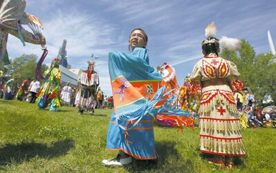 Daelyn Prince takes part in the Grand Entry dance for an Aboriginal Day powwow on the fields of The Forks National Historic site Saturday afternoon.