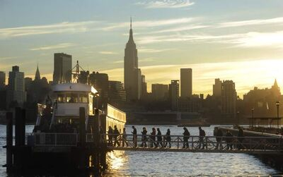 Commuters board a ferry in Hoboken, N.J., on Nov. 1 as Manhattan moves closer to normal.