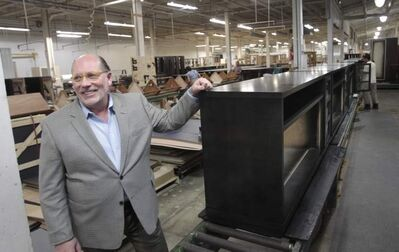 CEO Doug Buhler has watched his business shift away from cabinets and retail to niche clients who are willing to pay for long-enduring bedroom and office furniture.