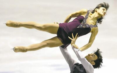 Koji Sasahara / the associated pressCanada�s Meagan Duhamel and Eric Radford do their routine Saturday in the ISU World Team Trophy figure skating competition. They finished second in pairs.