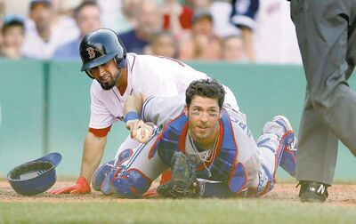 Michael Dwyer / the associated pressToronto Blue Jays catcher J.P. Arencibia looks for the out call as Boston Red Sox�s Shane Victorino slides home. Jose Bautista gunned Victorino down from right field with his cannon arm.