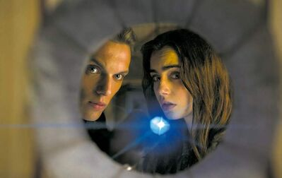 Jamie Campbell Bower, left, and Lily Collins are shadow-hunters tasked with killing demons.