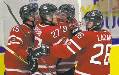 frank gunn / THE CANADIAN PRESSWinnipeg Jets prospect and Team Canada sniper Nic Petan (19) is swarmed by teammates in Sweden after potting the winner against Slovakia.