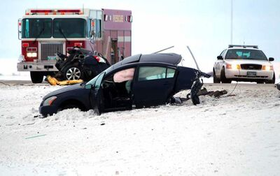 Police and emergency personnel at the scene of a collision on McGillivray Boulevard this morning