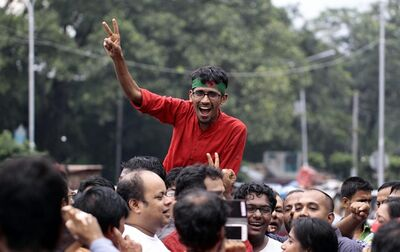 A Bangladeshi activist celebrates the verdict against Jamaat-e-Islami party leader Abdul Quader Mollah in Dhaka, Bangladesh, Tuesday, Sept. 17, 2013. The country's Supreme Court on Tuesday sentenced Mollah to death for committing crimes against humanity during the nation's 1971 independence war against Pakistan. (AP Photo/A.M. Ahad)