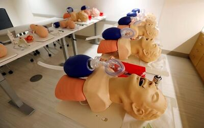 FILE - In this Friday, Aug. 4, 2017 file photo, mannequins are arranged to train CPR to incoming medical students in Jackson, Miss. A study released on Sunday, Nov. 12, 2017 shows women are less likely than men to get CPR from a bystander and more likely to die, and researchers think that reluctance to touch a woman's chest may be one reason. (AP Photo/Rogelio V. Solis)