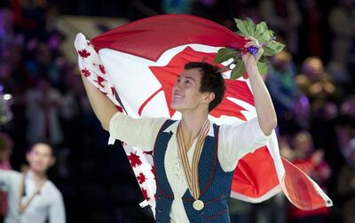 Men's gold medalist Patrick Chan from Canada skates a victory lap during victory ceremonies at the World Figure Skating Championships Friday, March 15, 2013 in London, Ont.. THE CANADIAN PRESS/Paul Chiasson