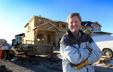 Manitoba Home Builders Association President Mike Moore in front of home being built in Bridgwater Forest.