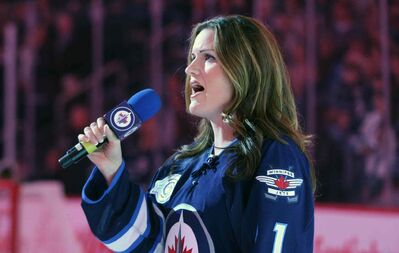 Stacey Nattrass sings the national anthem at the MTS Centre before a pre-season game.