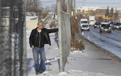 Area resident Alan Castell stands by the fence behind his home on Queen Street that runs along Century Street. The Winnipeg  Chamber of Commerce wants to erect a wall along his back lane, part of a $7-million initiative to beautify the airport-to-downtown traffic route.