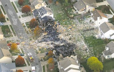 PHOTOS BY Matt Kryger / The Associated PressABOVE: An aerial photo shows the two homes that were demolished by an explosion in Indianapolis Saturday. About three dozen homes were  damaged or destroyed and two people were killed, authorities said Sunday. ABOVE RIGHT: Firefighters were surprised to come across a big blaze.