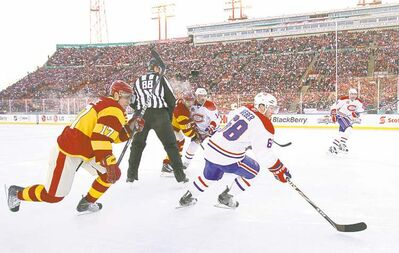 Montreal Canadiens defenceman Yannick Weber is chased by Calgary Flames' Rene Bourque during the 2011 Heritage Classic in Calgary.