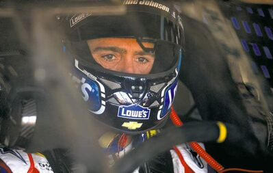 Jeff Siner / Charlotte Observer / MCTNASCAR Sprint Cup Series driver Jimmie Johnson waits for the start of practice at Charlotte Motor Speedway.