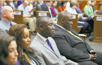 Attorneys representing Trayvon Martin's family sit stoically as George Zimmerman's verdict is read.