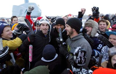 Mike Richards and Andrew Ladd (in the middle of the photo) had a street hockey game instead of an NHL game.