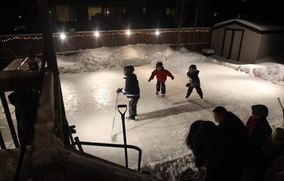 The kids have fun on a backyard rink at a home in Winnipeg's Royalwood subdivision. University of Guelph scientists want to know how climate affects such rinks.