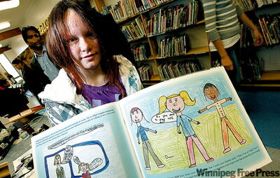 Grade 8 David Livingstone student Dani Kaye proudly shows off a page she drew in book published by FASD students. It's already sold 250 copies and 100 more are being shipped to the Northwest Territories.