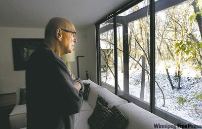 Dr. Jack  Fainman gazes at the spot behind his St. Vital home where gunman crouched to fire bullet that narrowly missed killing him.