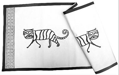 This July 2010 publicity photo provided by Dolma Fair Trade shows a Tiger runner made of cotton for a table in Burlington, V.T. The local artisans were inspired to create an animal motif by a nearby tiger preserve in Ranthambore, a city in Rajasthan, India. (AP Photo/Dolma Fair Trade, Rachael Charbonneau)