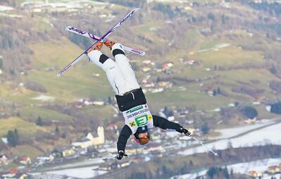 Canucks Alex Bilodeau and Justine Dufour-Lapointe (left) spend much of their time upside-down. Saturday they obtained an unusual view of the terrain in Kreischberg, Austria.