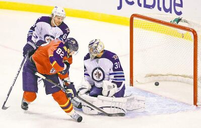 Rhona Wise / reutersFlorida�s Tomas Kopecky is right in Ondrej Pavelec�s face on this goal by Panthers teammate Brian Campbell. Jets blue-liner Ron Hainsey arrives too late.