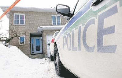 Adrian Wyld / The Canadian PressA police cruiser sits outside the house of Sen. Patrick Brazeau in Gatineau, Que. Brazeau was kicked out of the Conservative caucus Thursday.