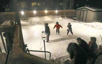 JOE BRYKSA / WINNIPEG FREE PRESSThe kids enjoy a backyard rink at a home in Winnipeg�s Royalwood subdivision. University of Guelph scientists want to know how climate change affects such rinks.