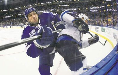 Dirk Shadd / Tampa Bay Times / MCTThe Lightning�s B.J. Crombeen (left) checks the Jets� Mark Stuart during first-period action at the Tampa Bay Times Forum in Tampa, Fla., on Thursday.