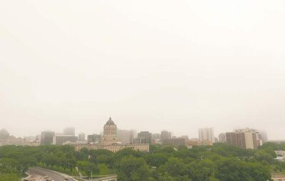 Fog and clouds hang over the Legislature Building and parts of downtown Winnipeg on Saturday morning.