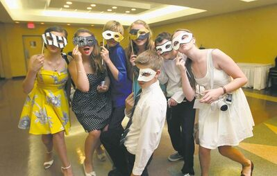 Aby (from left), Mackenzie, Avery, Hailey, Noah, Sydney and Liam (front) hide behind masks at farewell party, but were quick to bare their souls about their hopes and fears for high school.