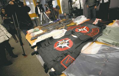 Phil Hossack / Winnipeg Free PressWinnipeg police show off some of the items seized through Project Falling Star, a nine-month investigation that targeted the Manitoba Warriors gang.