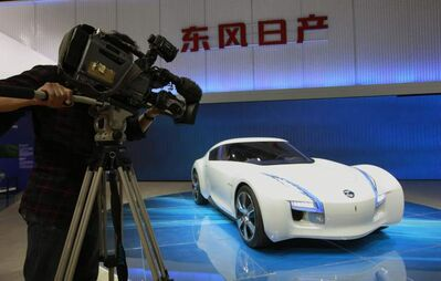 A cameraman films Nissan's latest concept and electronic car the Esflow.