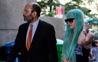Amanda Bynes, accompanied by attorney Gerald Shargel, arrives for a court appearance in New York, Tuesday, July 9, 2013. (AP Photo/Bethan McKernan)