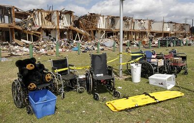 Wheelchairs are seen outside a damaged apartment comple, April 21, 2013, in West, Texas. THE CANADIAN PRESS/AP, Dallas Morning News, Michael Ainsworth