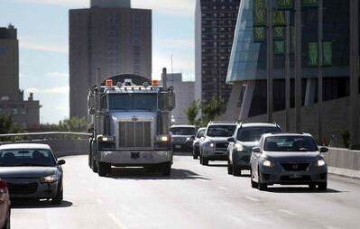 Tractor trailers and other heavy truck traffic makes it's way across the Provencher Bridge and down the boulevard Thursday afternoon.