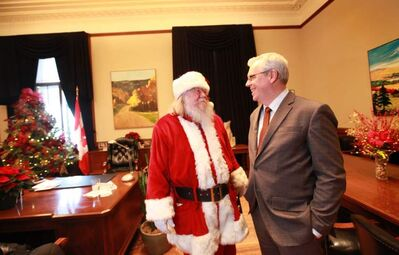 Santa visits Premier Greg Selinger's office during open house at the legislature Dec. 8.