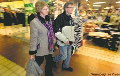 Linda and Ed Tomczak aren't fearful about debt during the holiday shopping season.