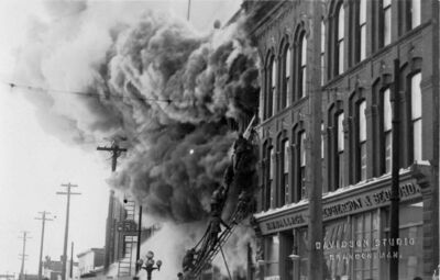 Crews battle the blaze in the Syndicate Block, at the southwest corner of Rosser Avenue and Seventh Street in Brandon, on Jan. 17, 1916.