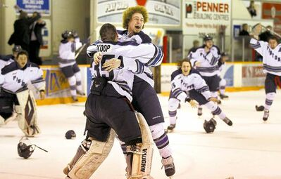 Steinbach defenceman Taylor Friesen hugs goalie Corey Koop after the Pistons eliminated the Dauphin Kings in Game 6 Wednesday night.