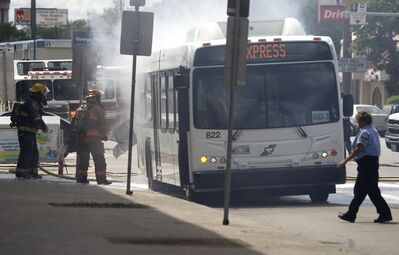 Firefighters extinguish a blaze in a transit bus that experienced mechanical difficulties on the 1200 block of Portage Avenue Saturday.