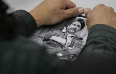 A relative holds a photo of Brian Sinclair, who died while waiting for medical care.