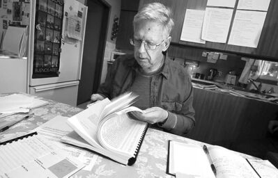 PHIL HOSSACK / WINNIPEG FREE PRESS Jim Garwood flips through affidavits Wednesday in the case of his mother's death.